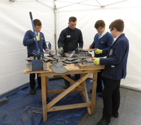 School pupils from Stirling trying traditional skills